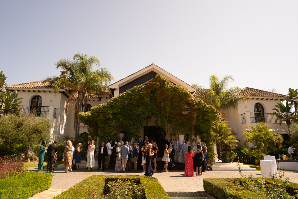 Guests enjoy welcome drinks at the front of the Villa - Chris Wallace, Carpe Diem Photography
