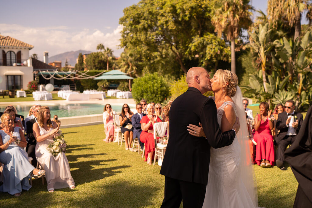The bride and groom have their first kiss as husband and wife - Chris Wallace, Carpe Diem Photography