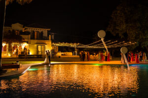 The newlyweds dancing in the moonlight by the pool - Chris Wallace, Carpe Diem Photography