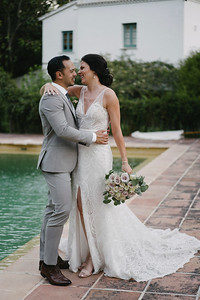 The bride and the groom beside the elegant swimming pool - Image Pedro Bellido Photograhy