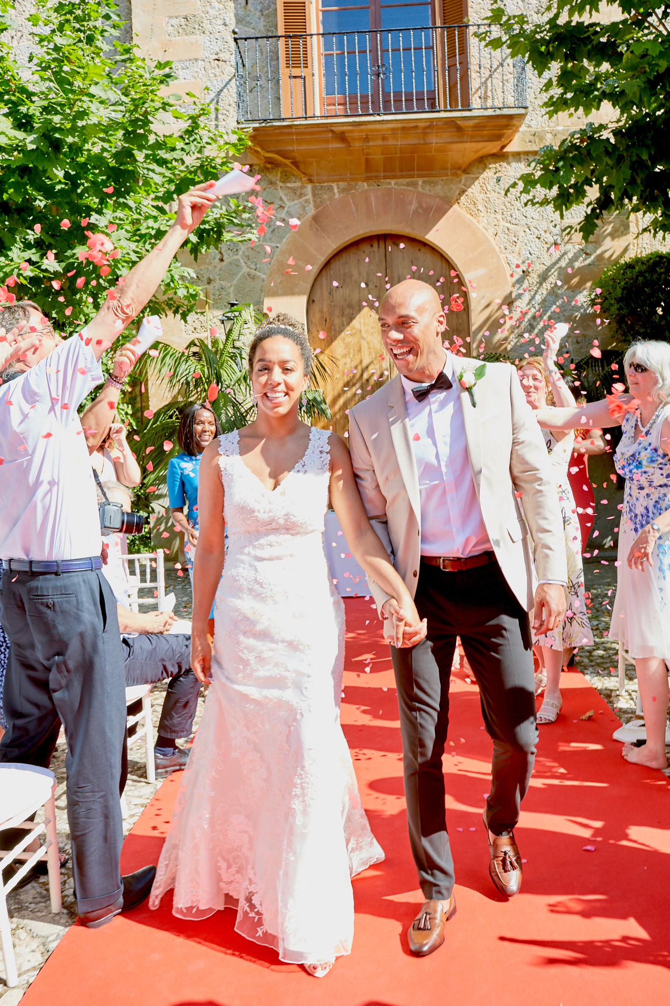 The newlyweds walk back down the aisle amidst a showering of confetti from family and friends, Thad Medford Photography