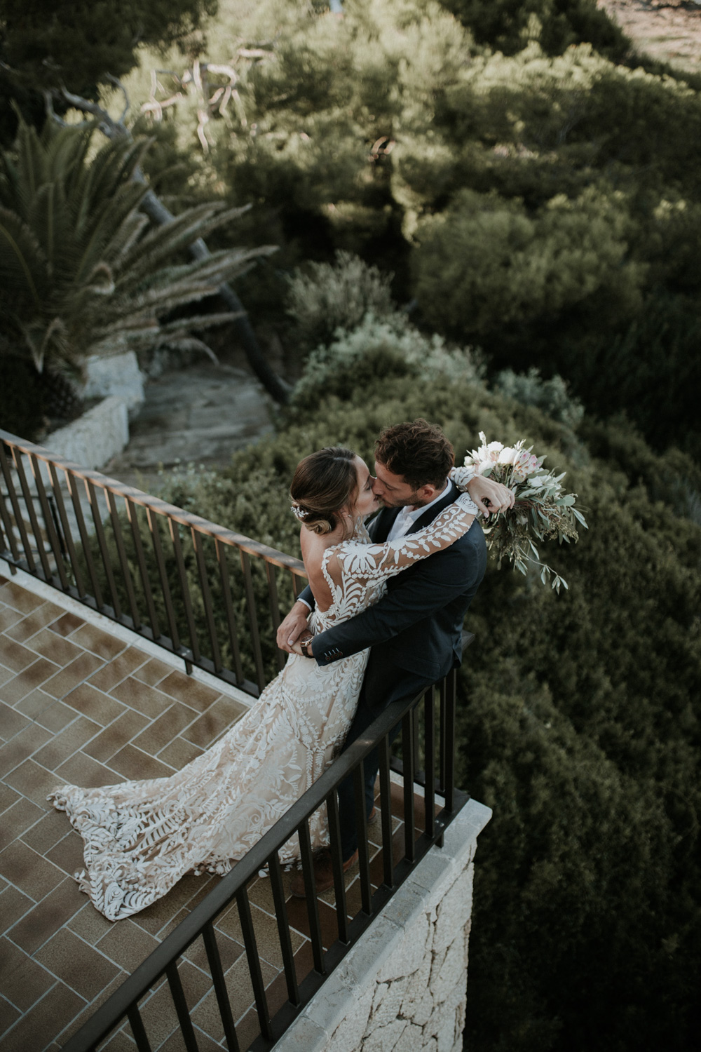 Newly Married Couple On Balcony