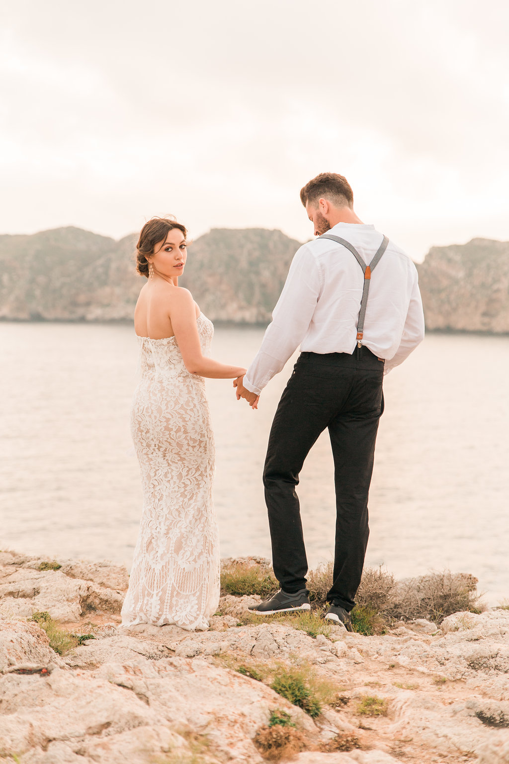Newly Married Couple By The Beach