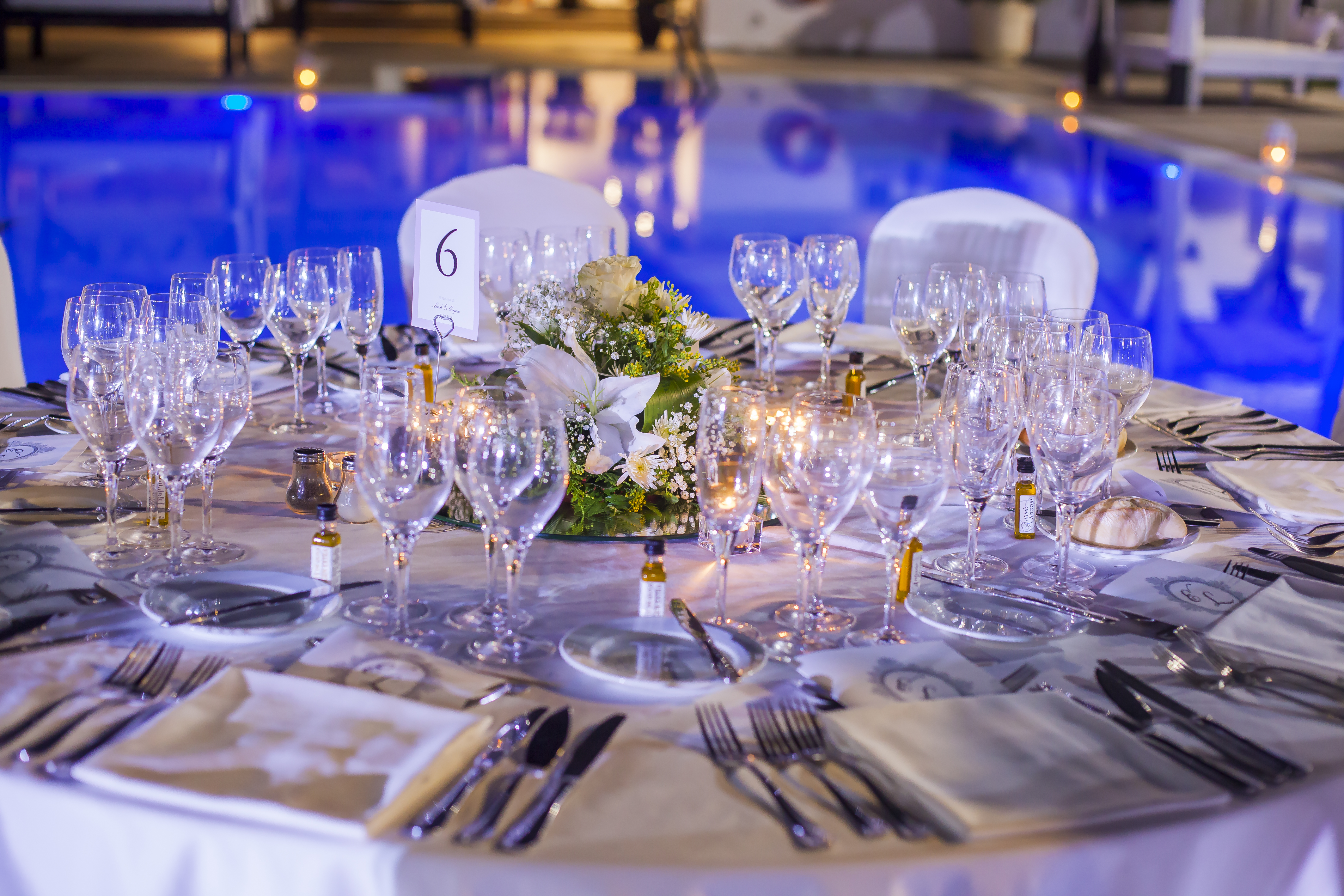 Stunning wedding table decor set against the backdrop of the fabulous beach club's pool
