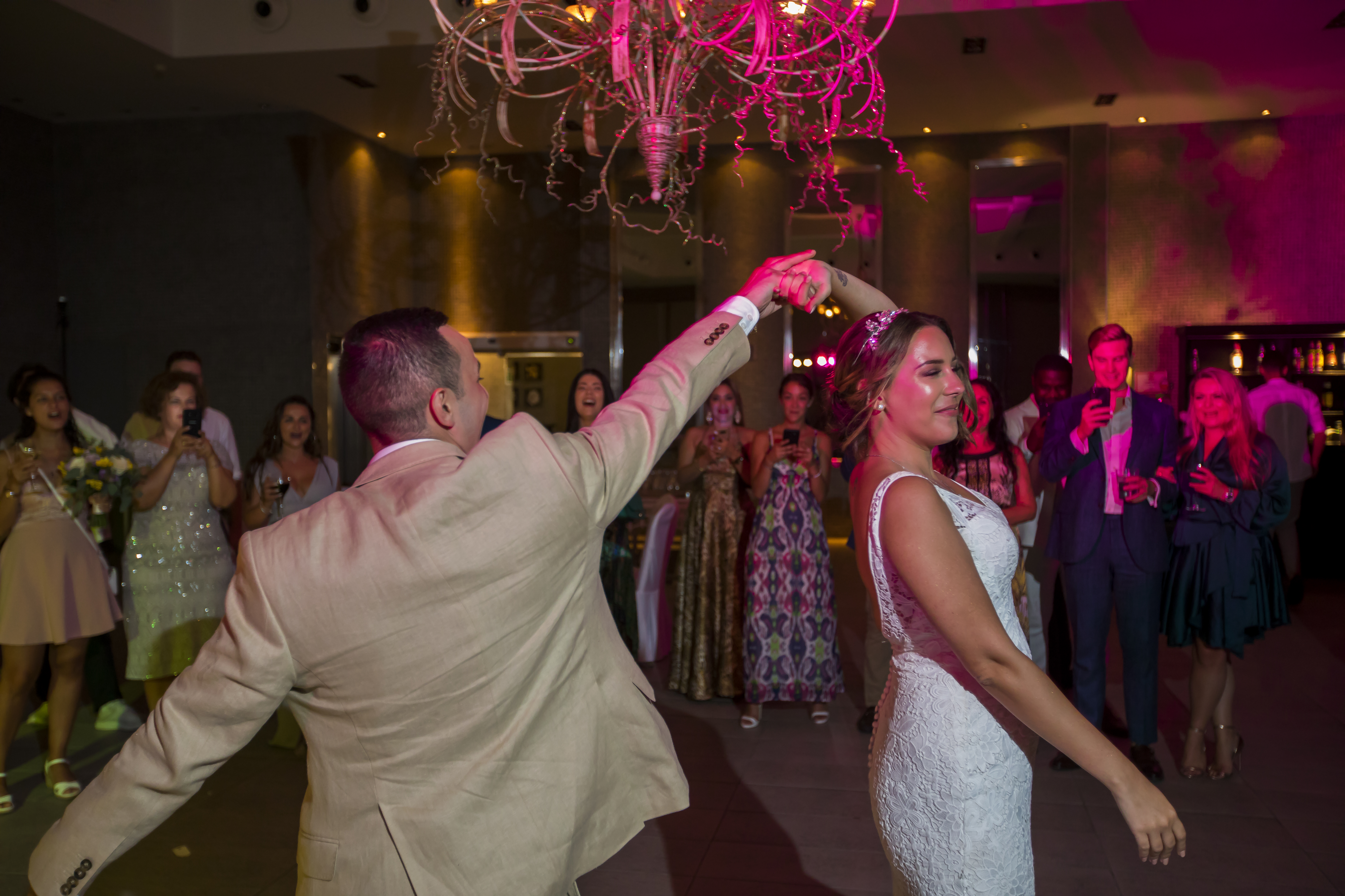 The bride and groom take to the dance floor in the beach club's party room room