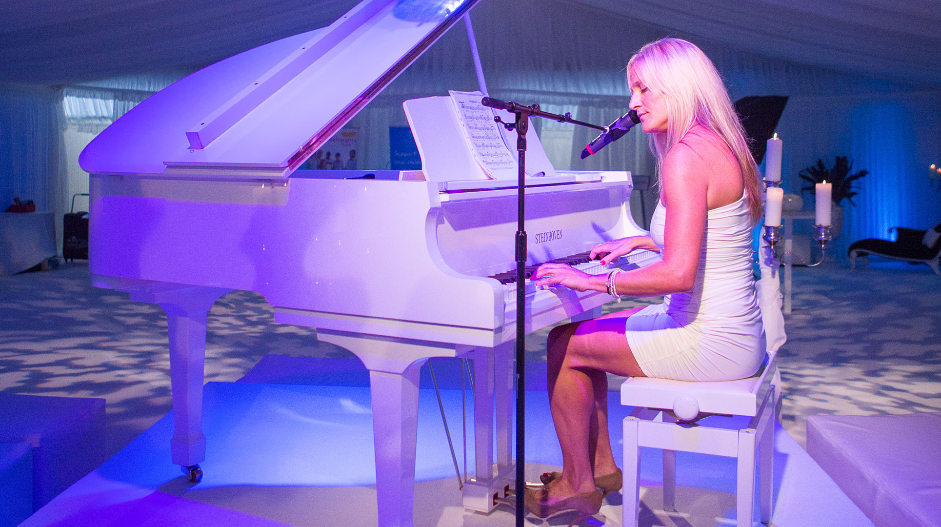 Lucy Sassoon on piano.