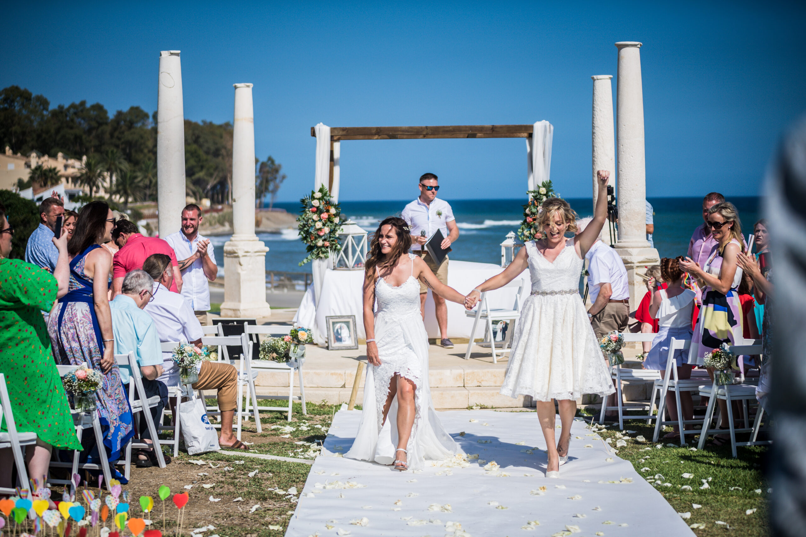 The newlyweds walking down the aisle after their beach-side ceremony - Rebecca Davidson Photography