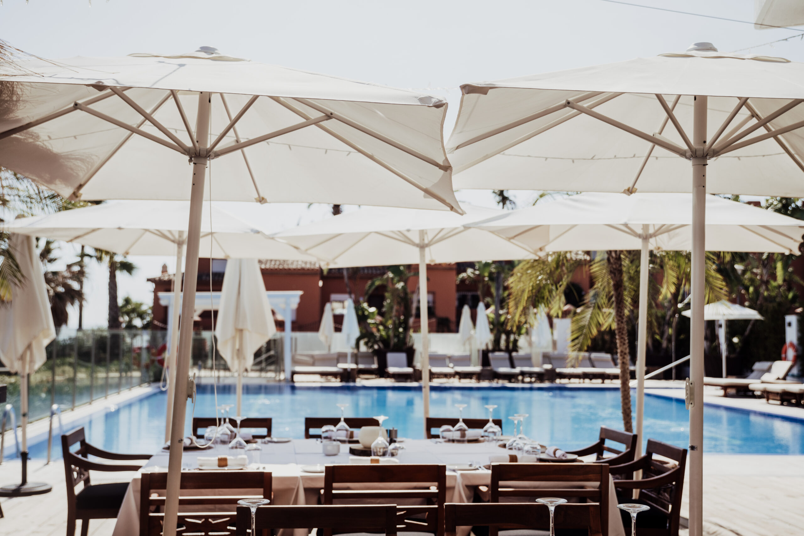 The Beach Club's deluxe swimming pool and table settings - Rebecca Davidson Photography