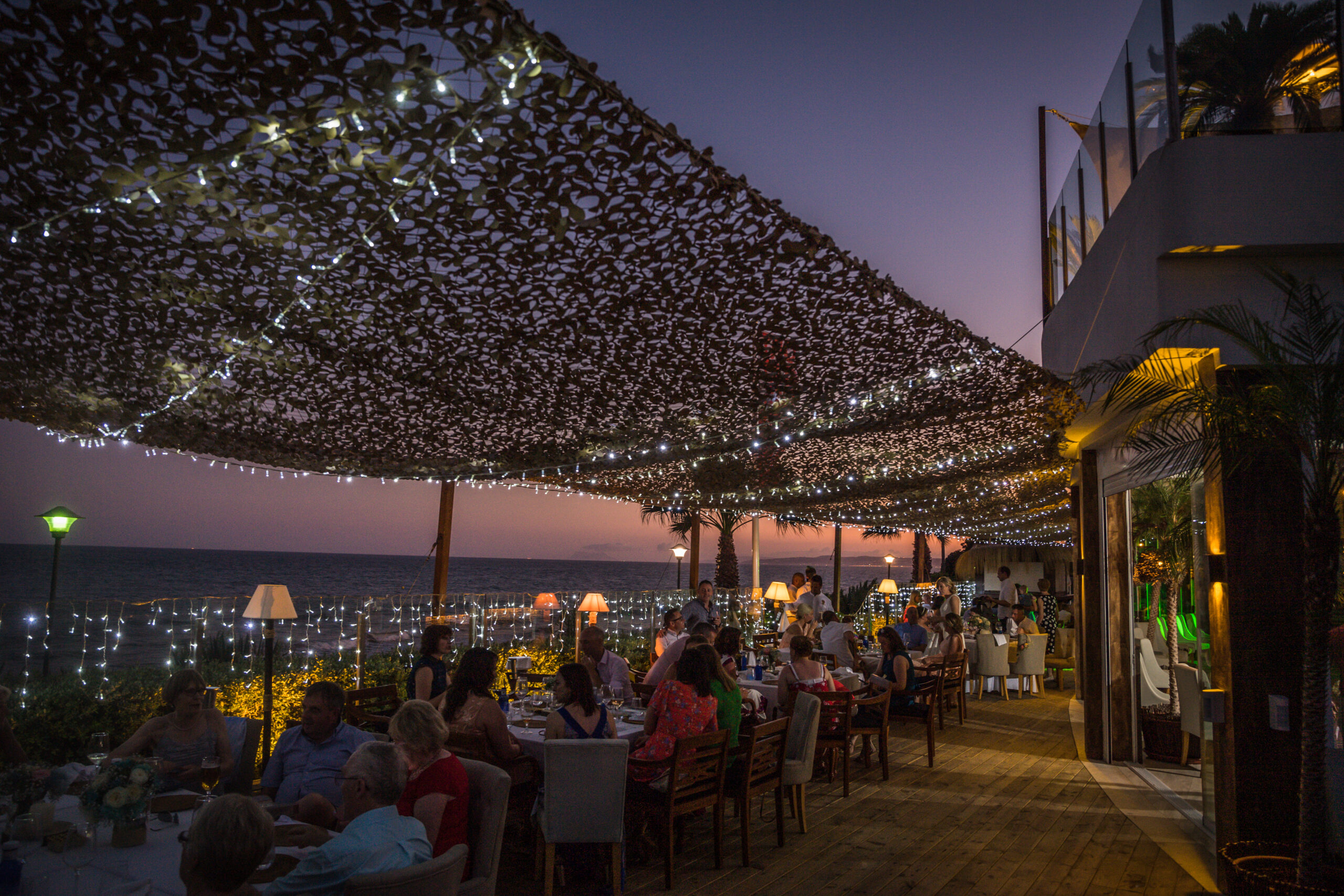The gorgeous lights of The Beach Club at night - Rebecca Davidson Photography
