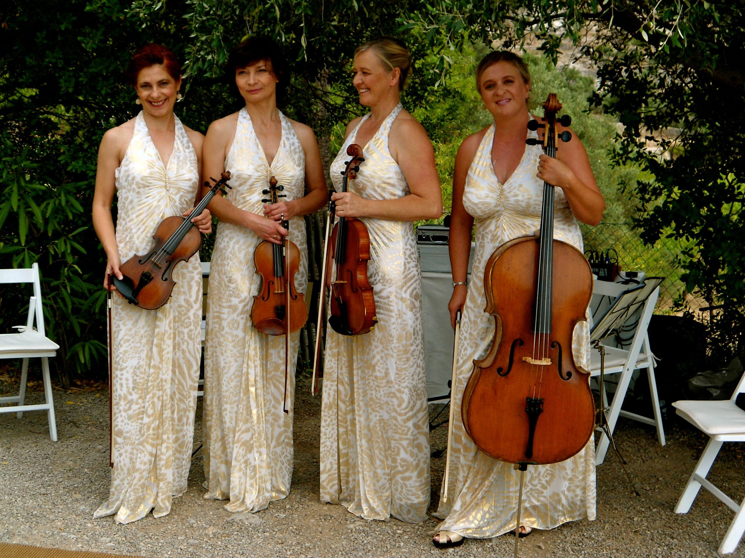 Soriana Ivaniv, wedding violinist in Mallorca (left) alongside other musicians