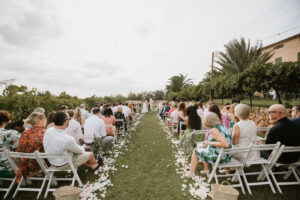 The bride and groom and their guests gather for the wedding ceremony on the vast Finca lawn