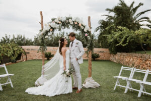 The bride and groom on the lawns of the Finca - Aimee K Photography
