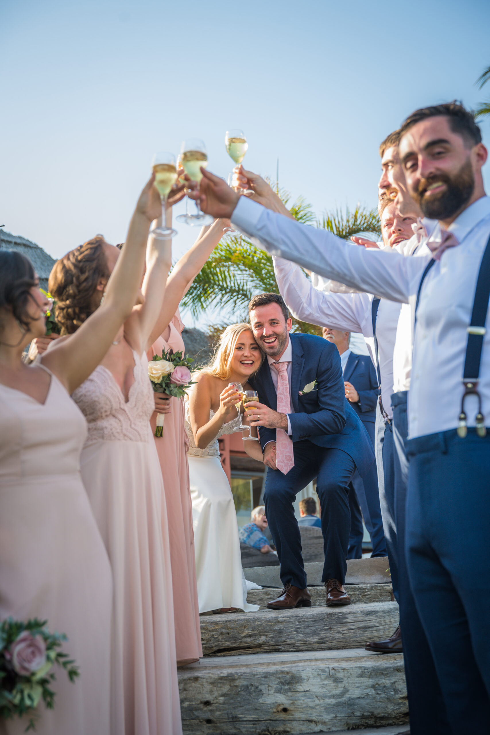 The bride and groom are toasted by family and friends - Rebecca Davidson Photography