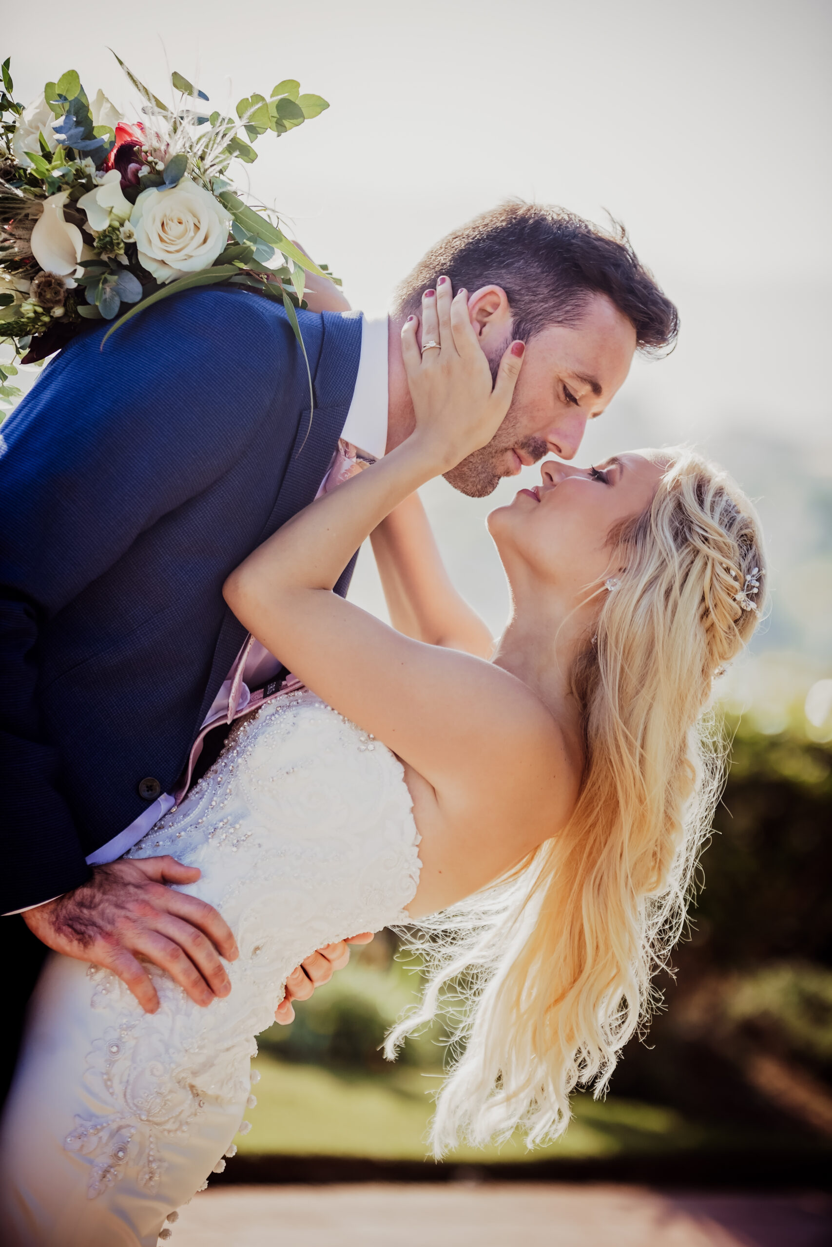 The bride and groom share a kiss after the ceremony - Rebecca Davidson Photography