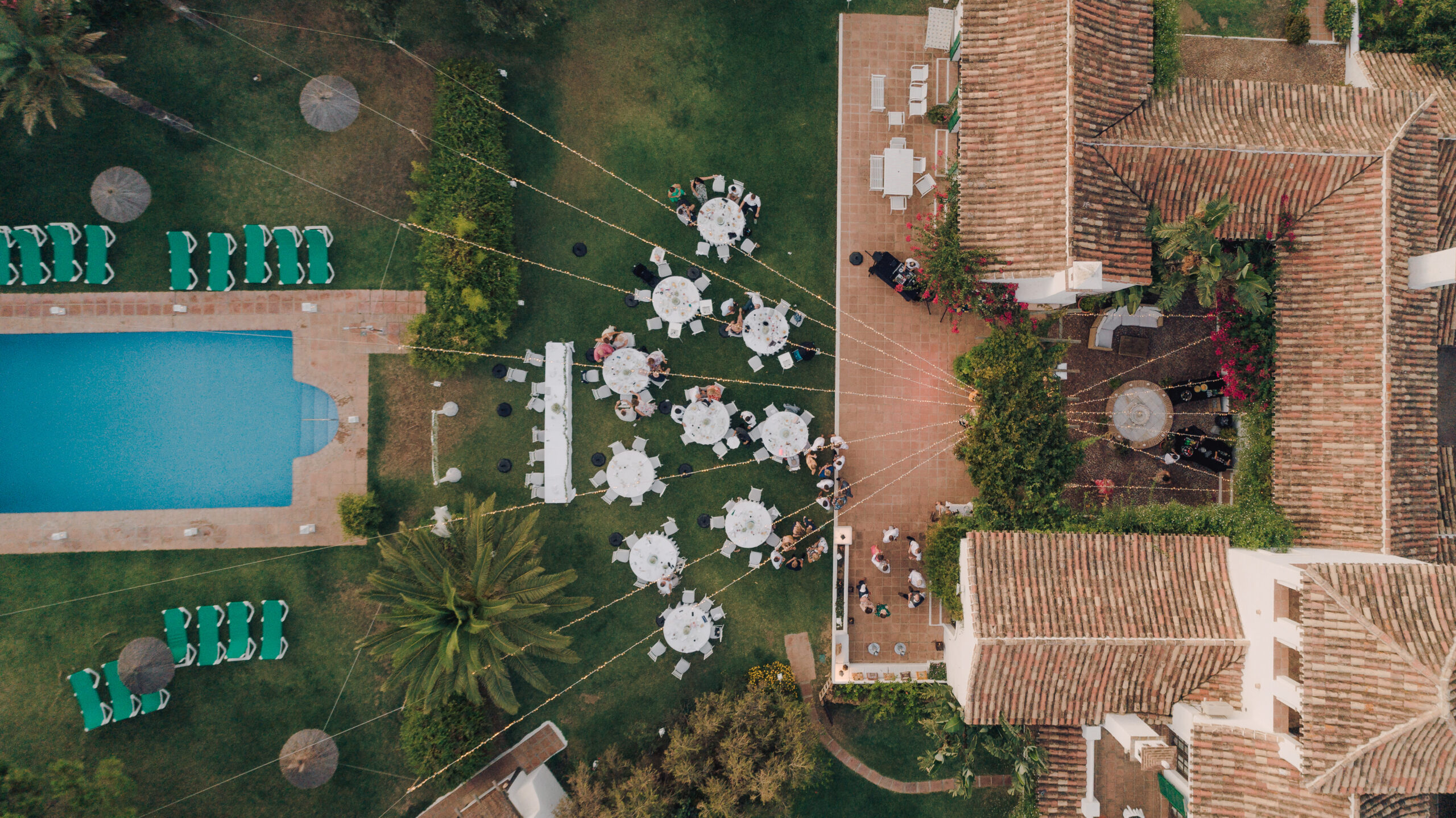 Aerial shot of the garden layout and pool - Hove & Co Photography
