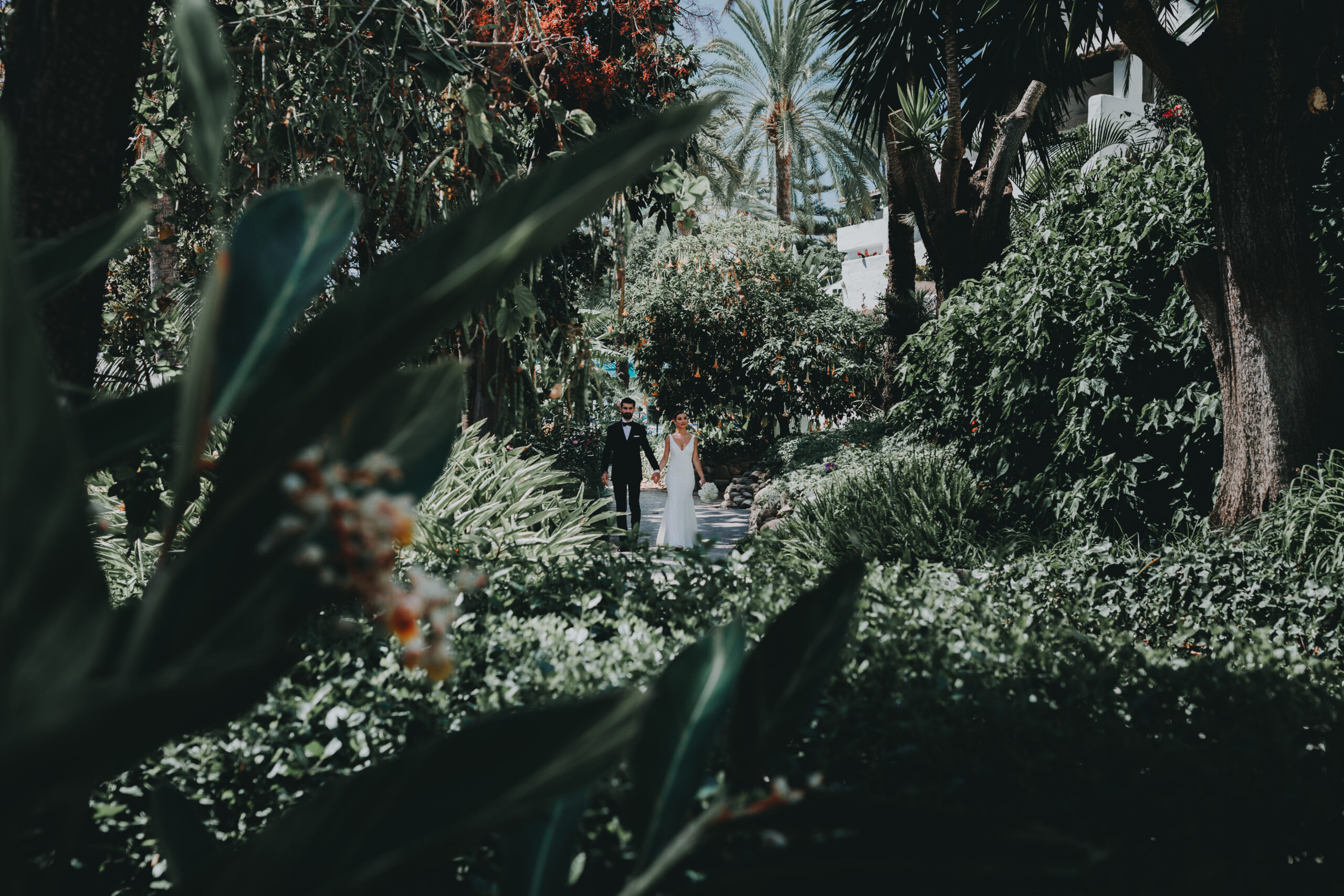 The bride and groom in the grounds of the stunning gardens - Gino K photography