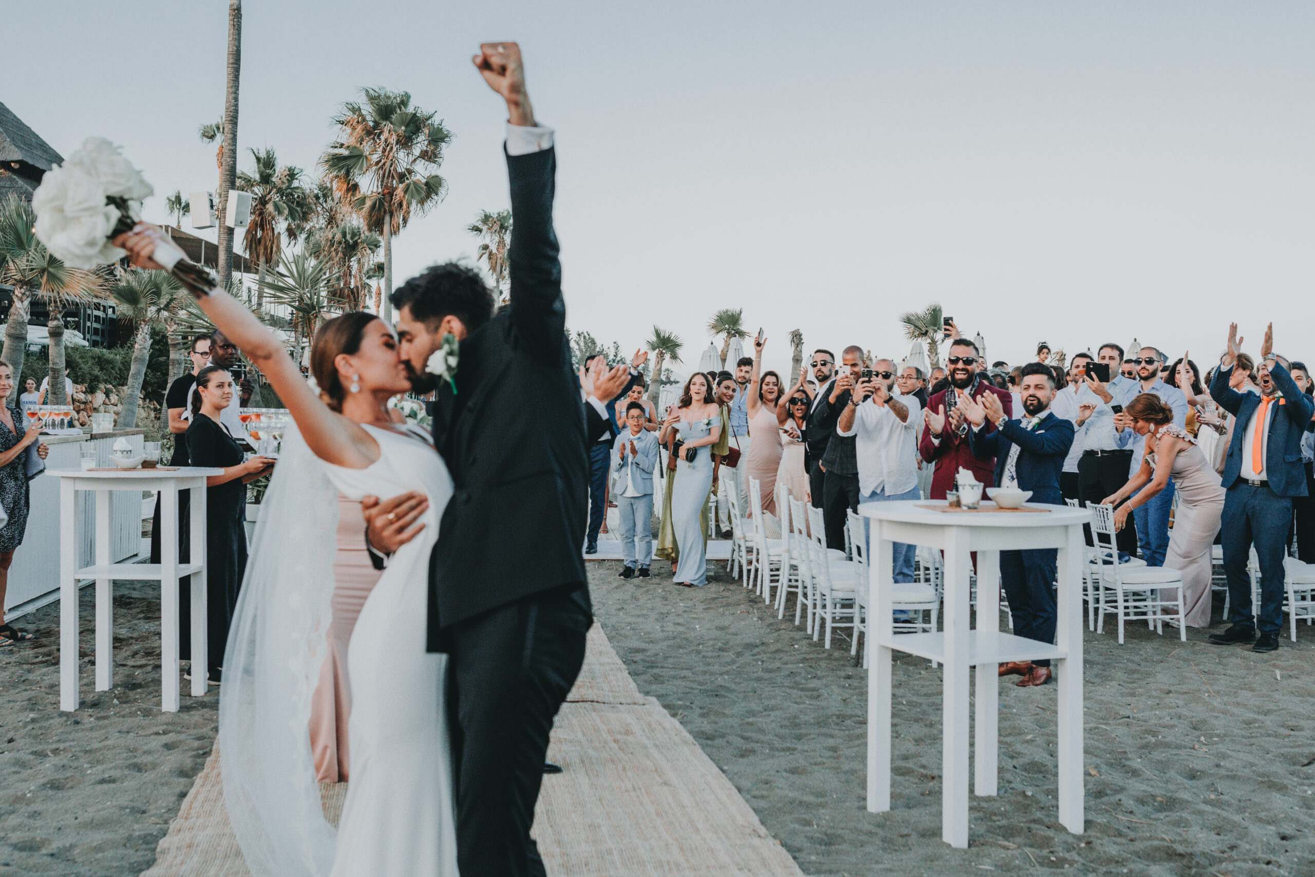 First kiss after walking back down the aisle as newlyweds - Gino K photography