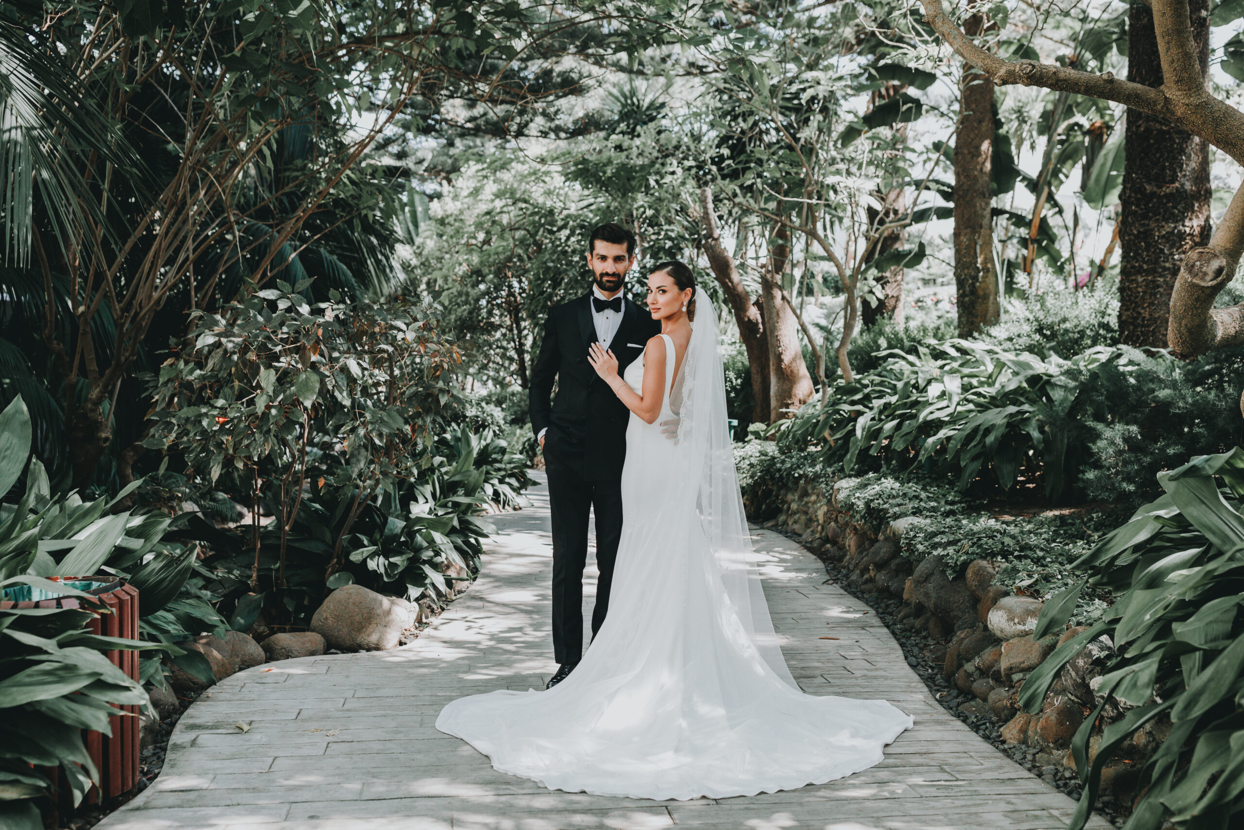 The bride and groom in the grounds of the beach club - Gino K photography