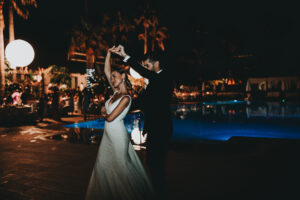 The bride and groom dance beside the pool - Gino K photography