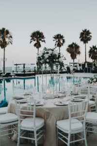 The beautiful wedding table setting beside the pool - Gino K photography