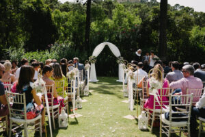 Guests awaiting the bride's arrival on the lawnof the Villa - Pedro Bellido Photography