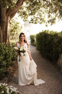 A beautiful bride whose hair and makeup have been perfected by Vesta