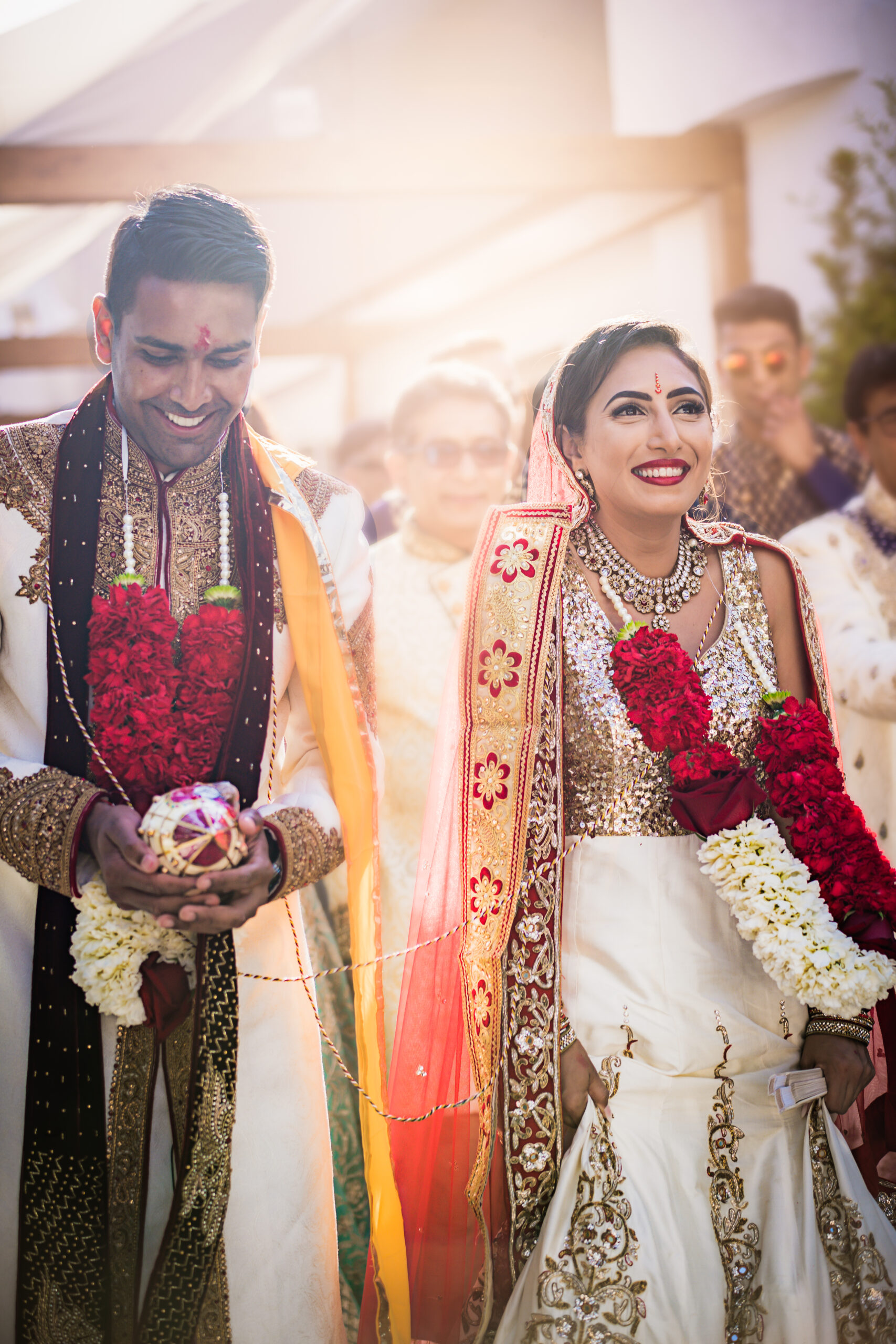 The stunning bridal couple in their traditional Indian wedding costumes - Rebecca Davidson Photography