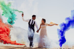The happy couple with colourful traditional flares - Rebecca Davidson Photography