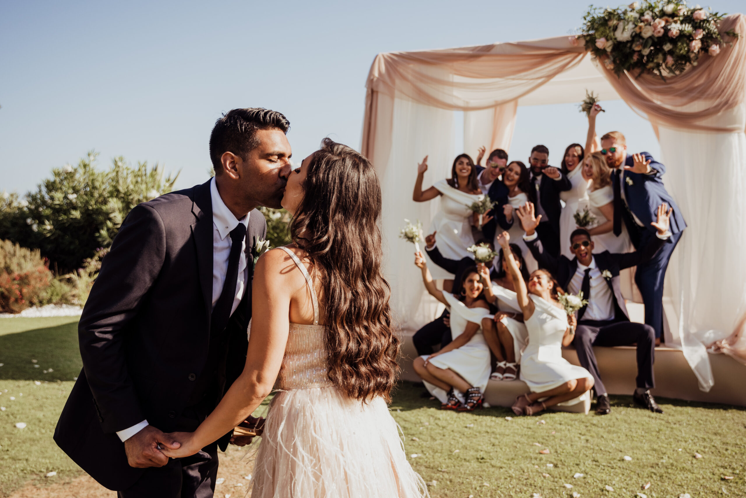The newlyweds and their guests in the villa's gardens - Rebecca Davidson Photography