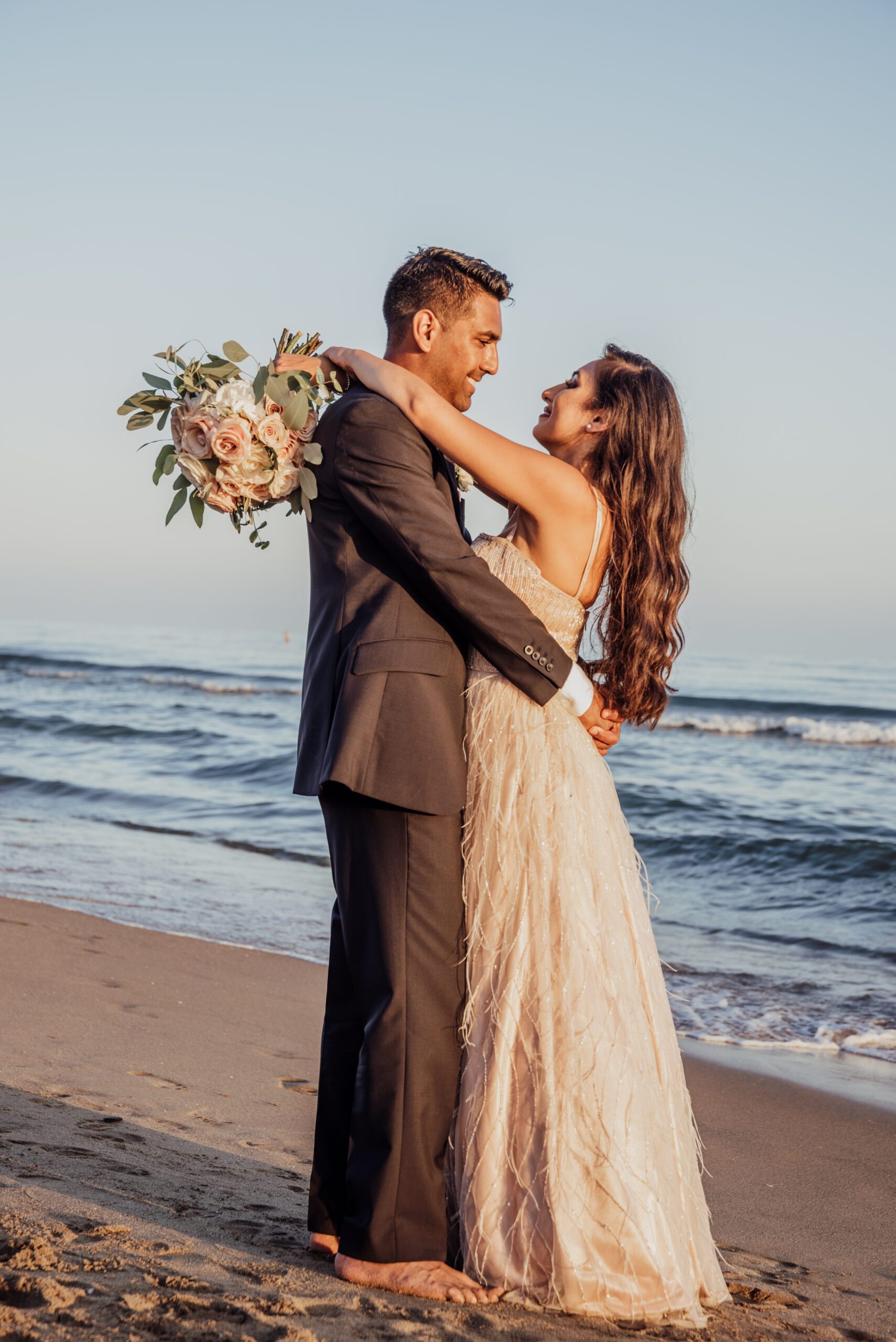 The bride and groom at the beach, on the villa's doorstep - Rebecca Davidson Photography