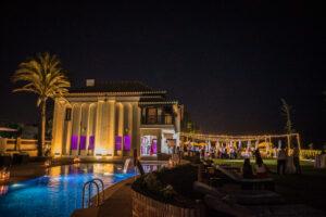 The stunning villa illuminated at night - Rebecca Davidson Photography