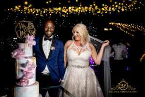 Bride, groom, and one majestic wedding cake - Balance Photography
