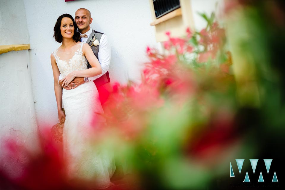 The bride and groom in the grounds of the wedding venue - Photography by Your Wedding Moments