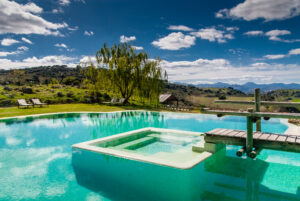 Infinity pool with built-in hot tub