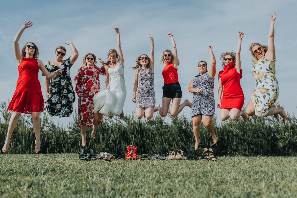 The Love Hunters - bridal party jumping