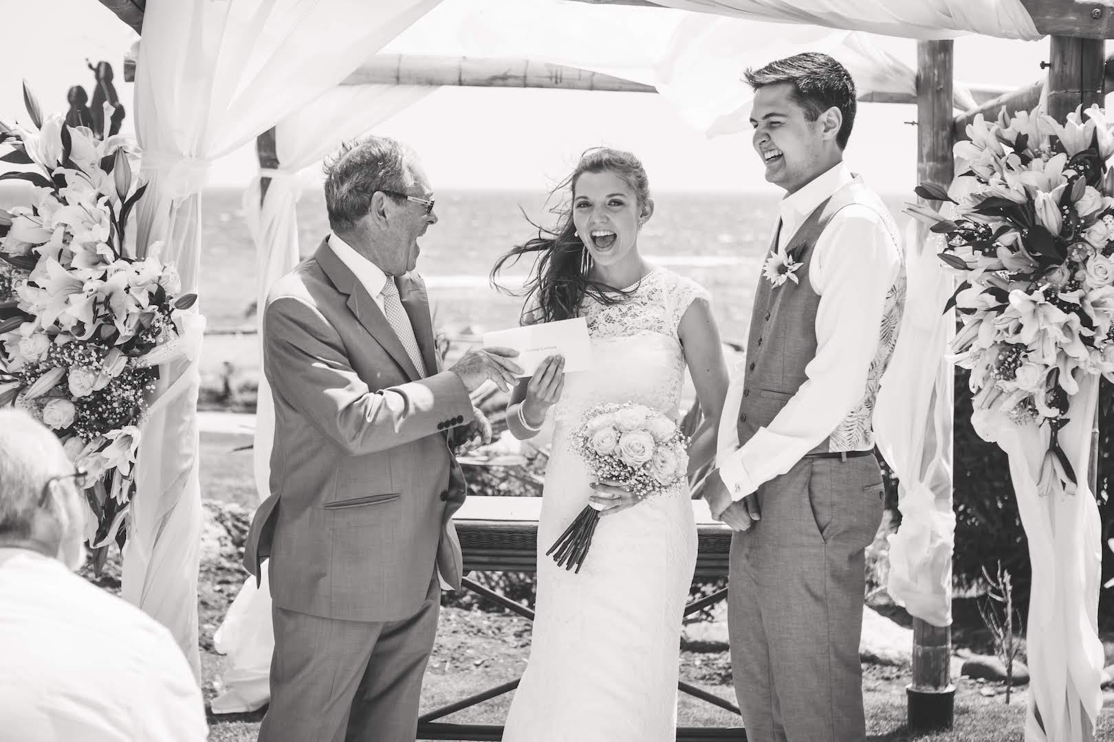Bride, groom and wedding celebrant