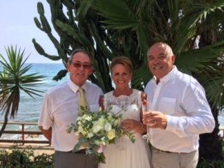 Newlyweds and celebrant, Kevin