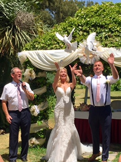 Wedding celebrant, Kevin with a bride and groom