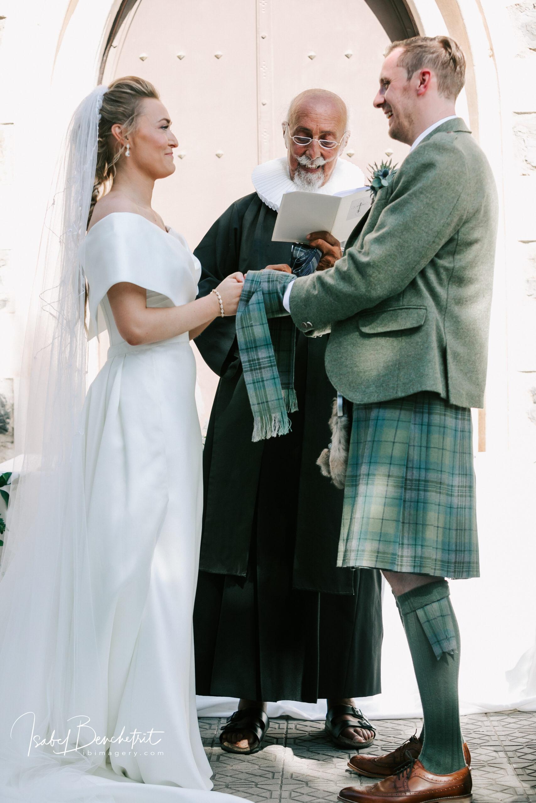 """Stylish Spanish wedding in Spain, the bridal couple saying """"I do"""""""