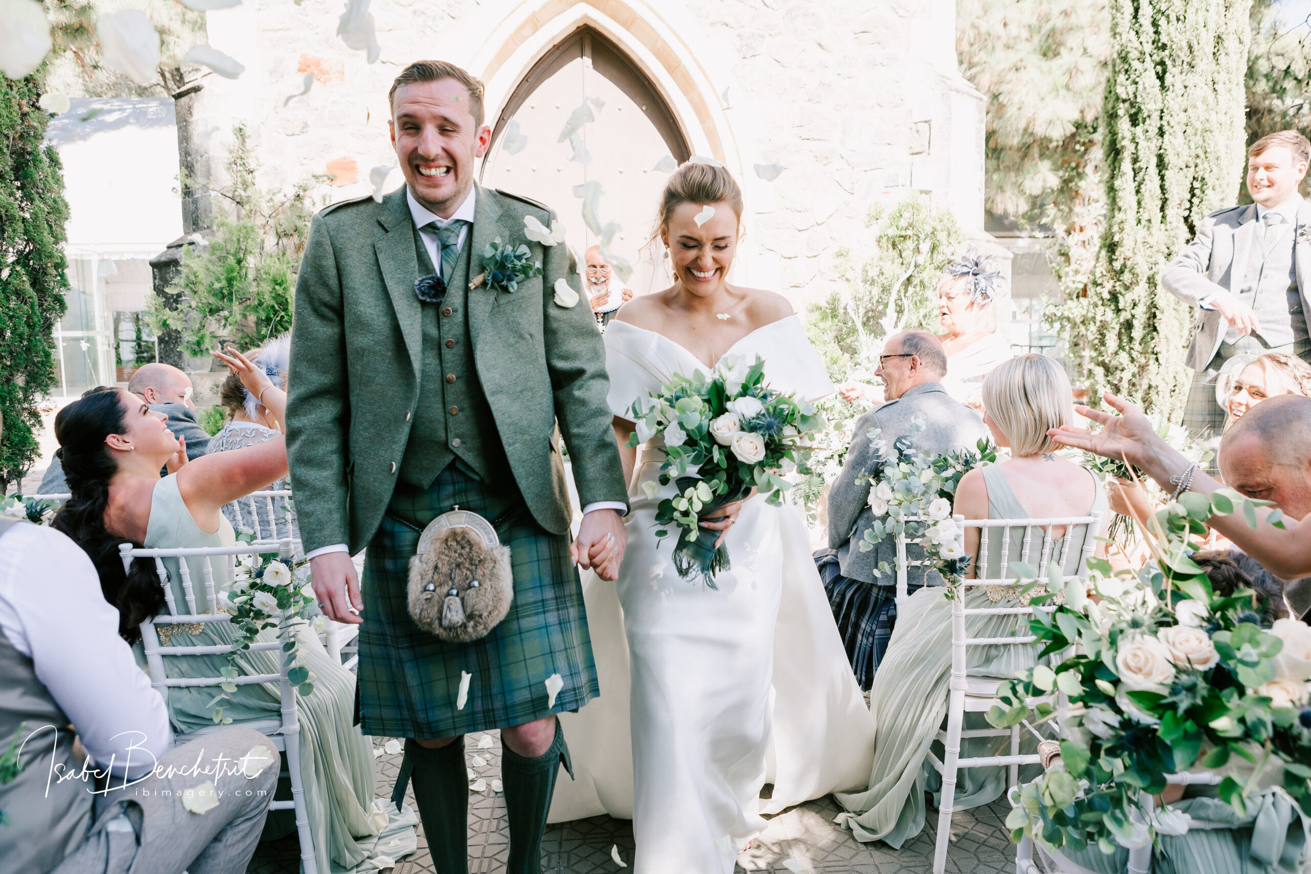 The newlyweds walk back down the aisle of the wonderful outdoor space near the old and cosy chapel.